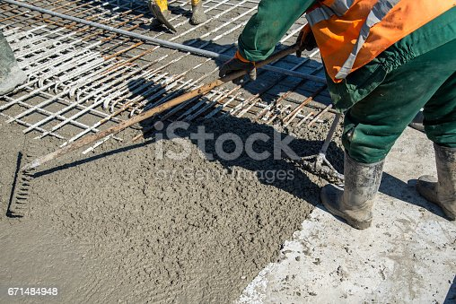 Close view on the concrete pouring on the construction site