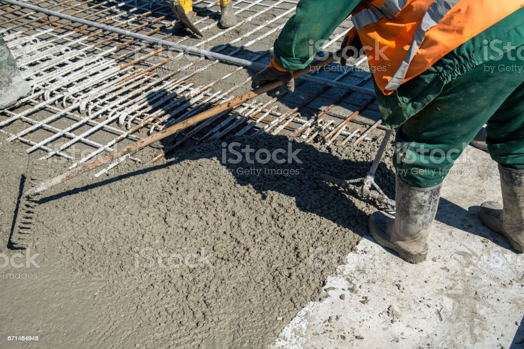 Concrete pouring on the construction site stock photo