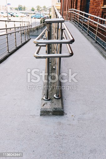666724598 istock photo Concrete ramp way with stainless steel handrail 1136043441