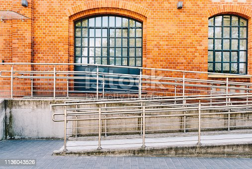 666724598 istock photo Concrete ramp way with stainless steel handrail 1136043526