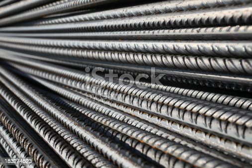 Stack of steel rebars for reinforcing concrete on a construction site. More pictures are in this lightbox: