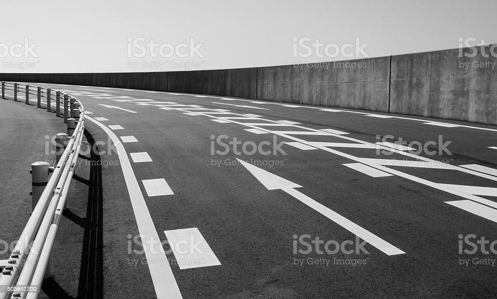 Concrete road with arrow symbol in black and white stock photo