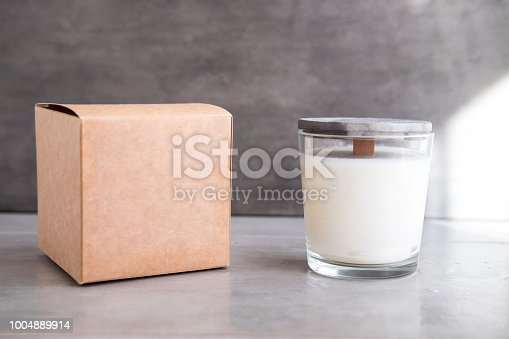 istock Concrete scented soy round candle on grey table 1004889914