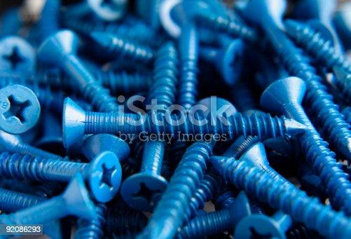 A pile of blue coated concrete screws