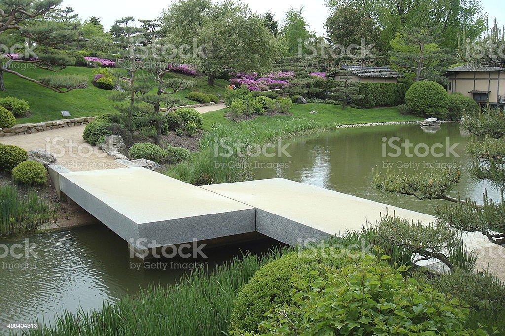 Concrete Slab Bridge in Japanese Garden stock photo