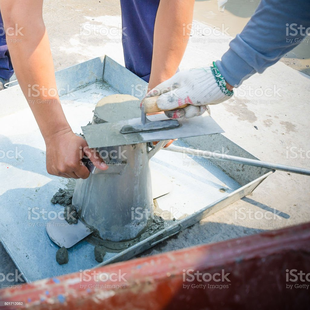 Concrete slump test before pouring a foundation stock photo