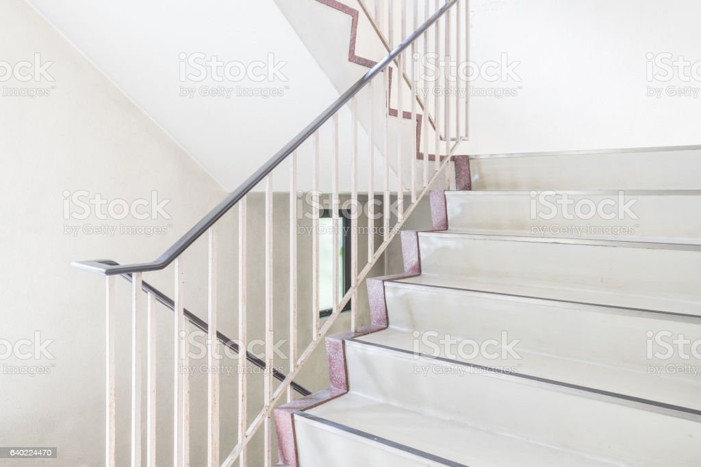 Concrete staircase with metallic handrail at modern buiding stock photo