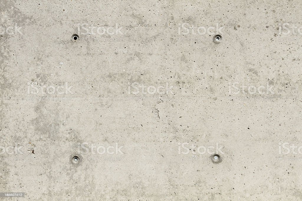 Concrete surface with four squared boreholes royalty-free stock photo