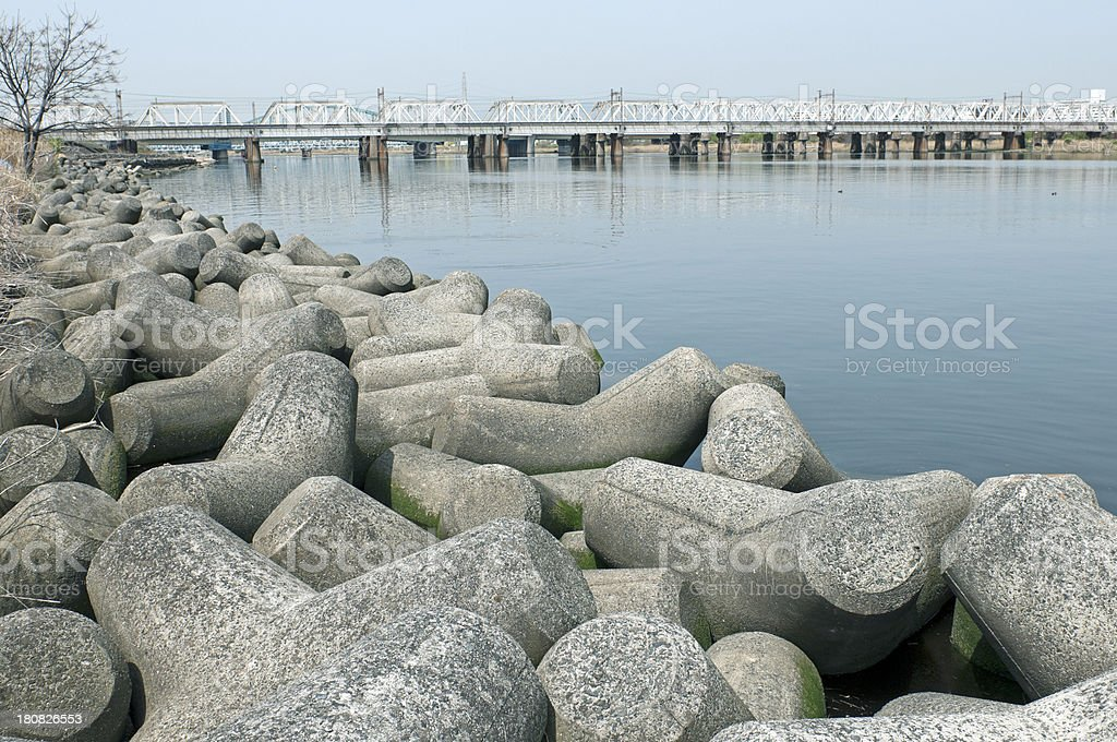 Concrete tetrapods lining riverbank in Japan royalty-free stock photo