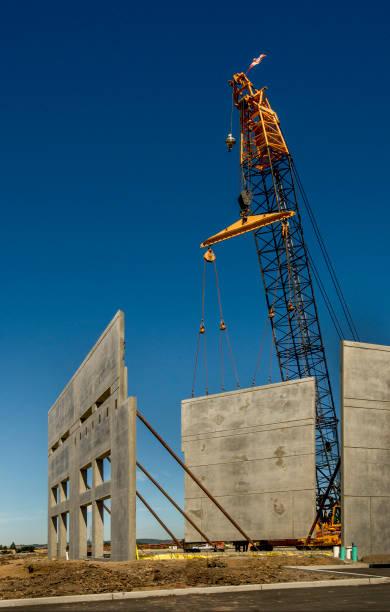 Concrete Tilt-up Construction with Crane stock photo