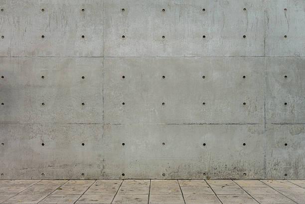 concrete wall and cement floor for copy space - versterkte muur stockfoto's en -beelden