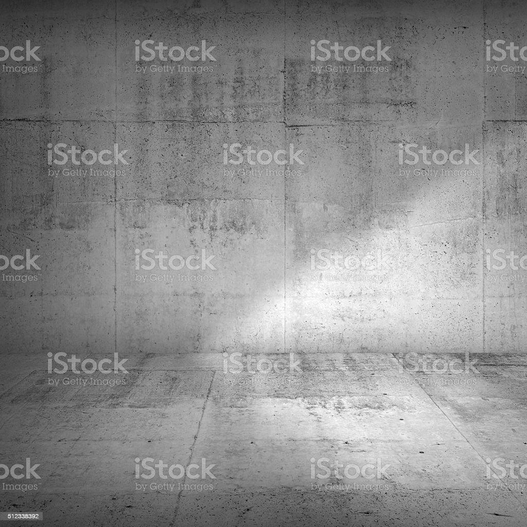 Concrete wall and floor with strong side illumination stock photo