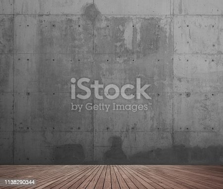 Concrete wall and wooden floor.