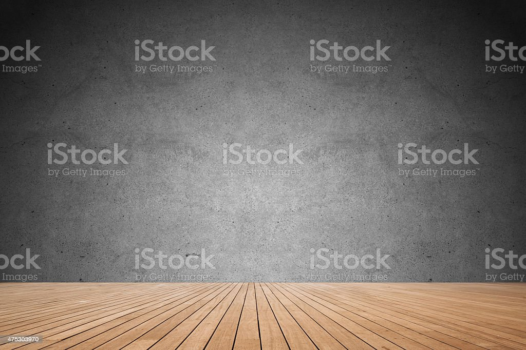 Concrete wall and wooden floor stock photo