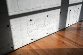 Concrete wall and wooden parquet, interior