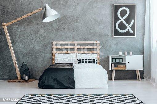 istock Concrete wall in simple dark room 826712304