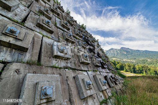 istock Concrete wall to protect the hillside from landslide and destruction. 1134872475