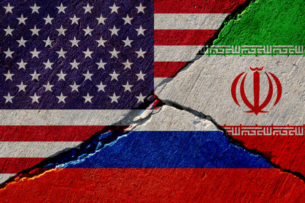 concrete wall with painted united states, russia and iran flags concrete wall with painted united states, russia and iran flags sanctions stock pictures, royalty-free photos & images