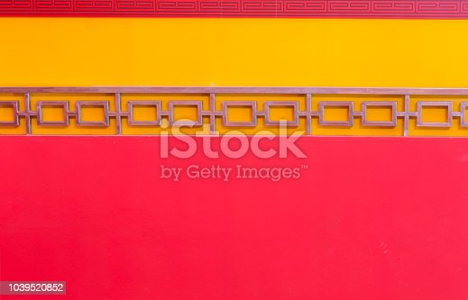 1084390994istockphoto Concrete wall with red background, Chinese pattern.Chinese New Year 1039520852