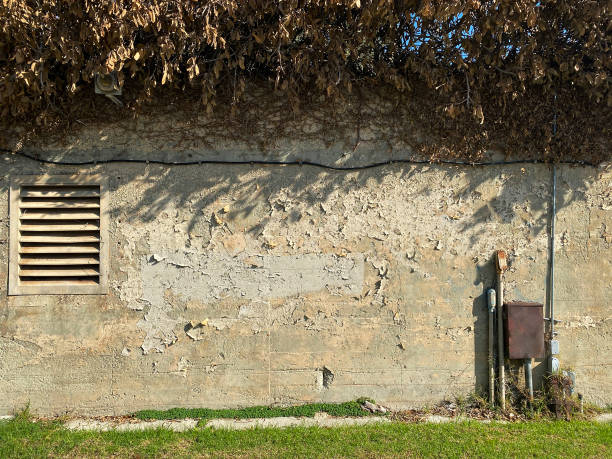 Concrete wall with vent and electrical connections. stock photo