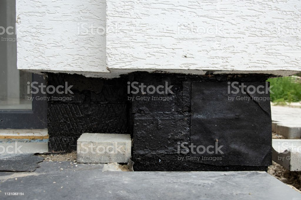 Waterproofing foundation bitumen and insulation with polystyrene foam...