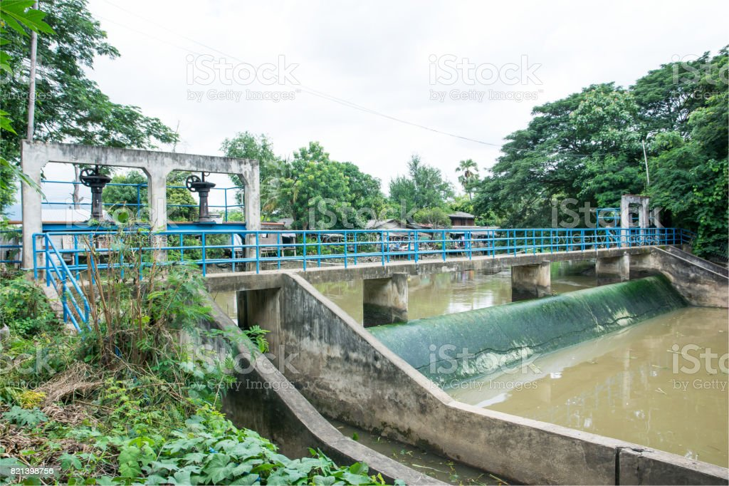 Concrete weir with bridge at the river for irrigation.River weir and bridge background stock photo