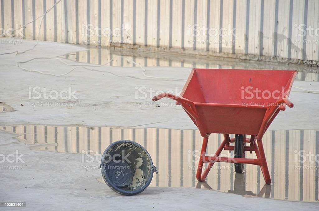 concrete wheel barrow with Can royalty-free stock photo