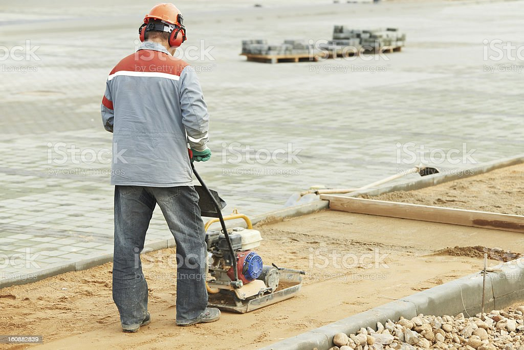 concrete worker work with compactor stock photo