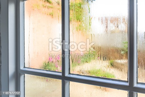 Condensation on an old window of a home