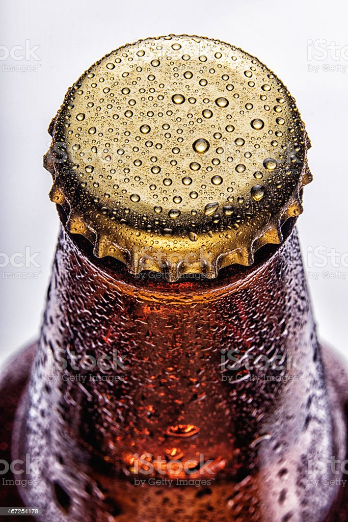 Condensation on top of brown beer bottle stock photo