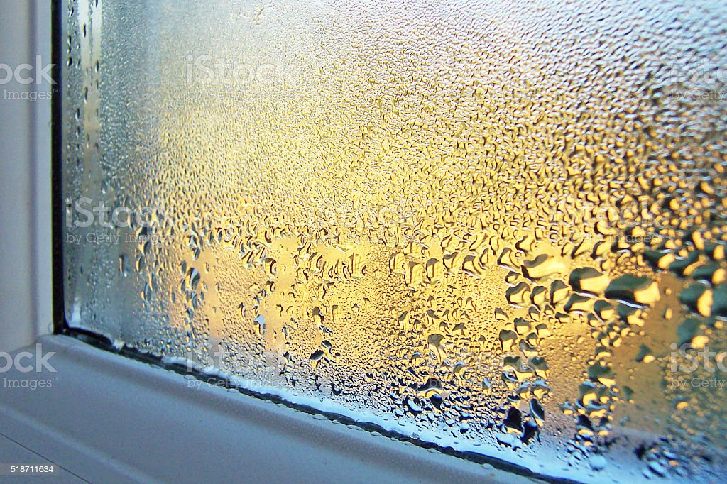 Condensation on Window Glass and Frame stock photo