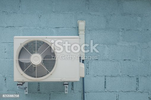 istock Condenser air conditioner with vintage brick background 820588258