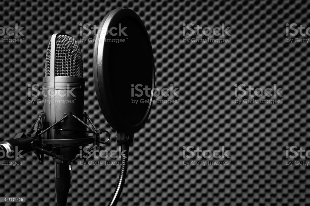 condenser microphone in recording studio for music background stock photo