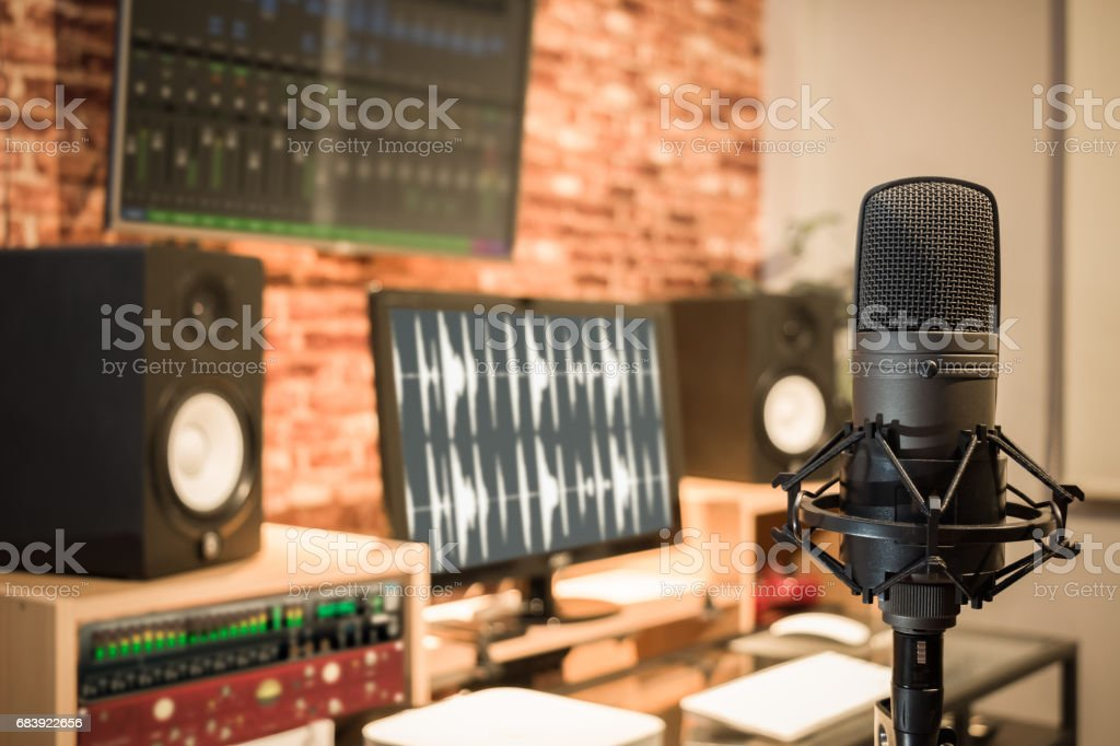 condenser microphone on digital recording studio background stock photo
