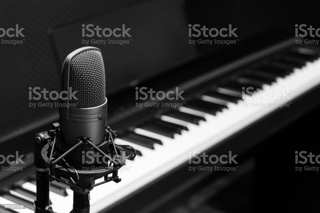 condenser microphone on piano background stock photo