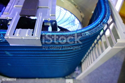 Closeup details of old external air-cooled condenser in water cooler