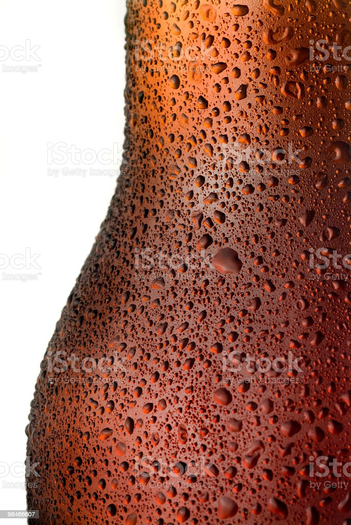 Condenstion drops in red beer bottle macro royalty-free stock photo