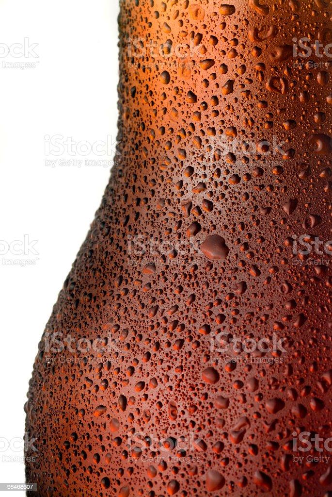 Condenstion drops in red beer bottle macro stock photo