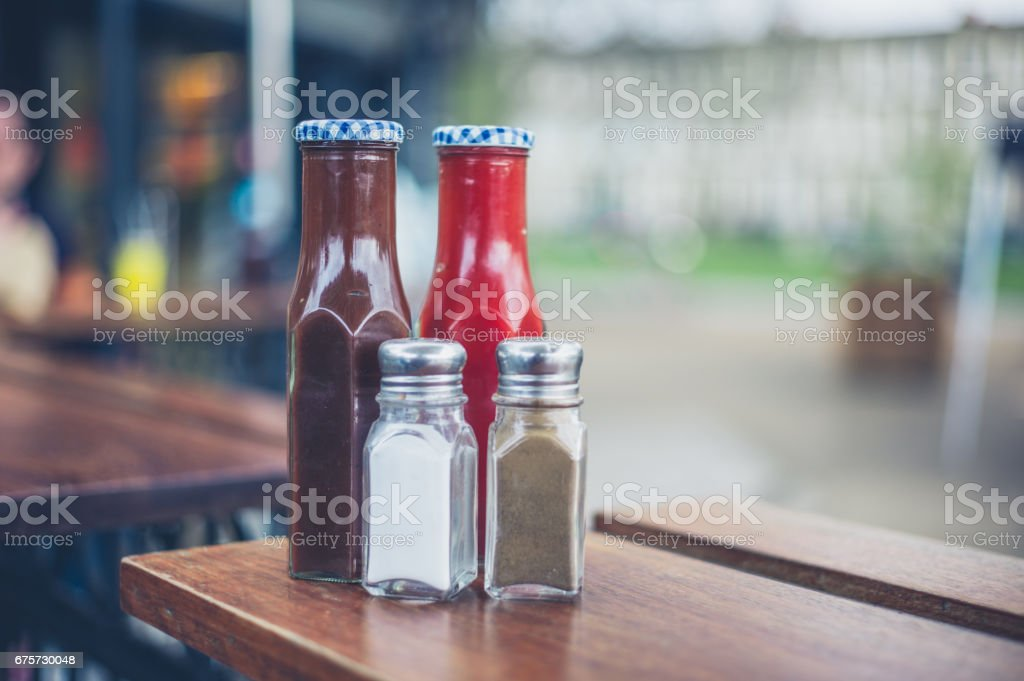 Condiments with salt and pepper stock photo