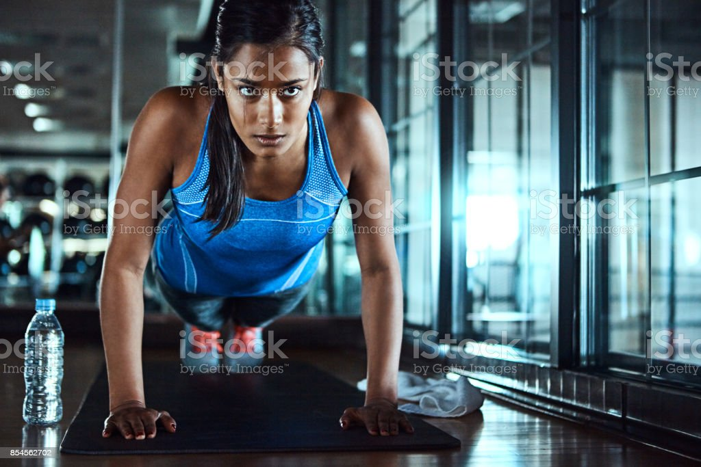 Conditioning her body stock photo