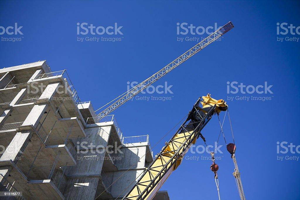 Condo under construction with crane royalty-free stock photo