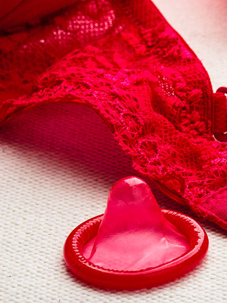 Condom with lace lingerie. – Foto