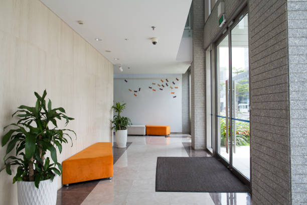 condominium building entrance - building entrance stock photos and pictures