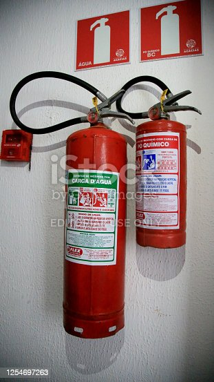 salvador, bahia / brazil - june 29, 2020: extinguisher for fire is seen in corridor of residential building in the city of Salvador.