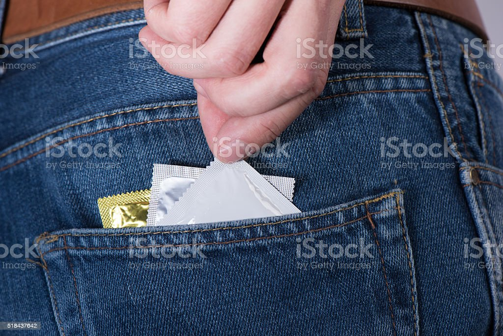 Condoms from the jean pocket stock photo