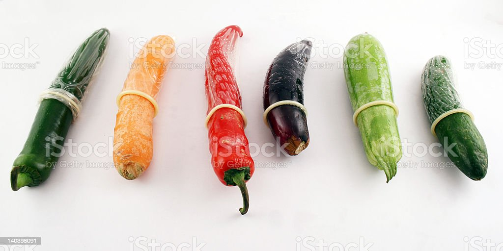 Condoms on vegetables royalty-free stock photo
