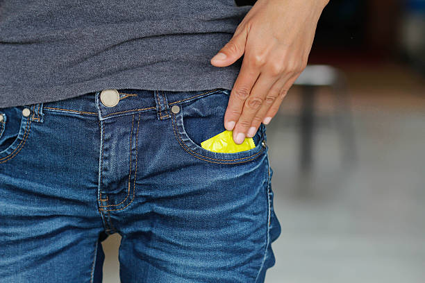 Condoms Condoms in jeans. sexually transmitted disease stock pictures, royalty-free photos & images
