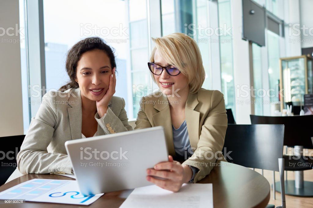 Conducting Negotiations in Cozy Coffeehouse royalty-free stock photo