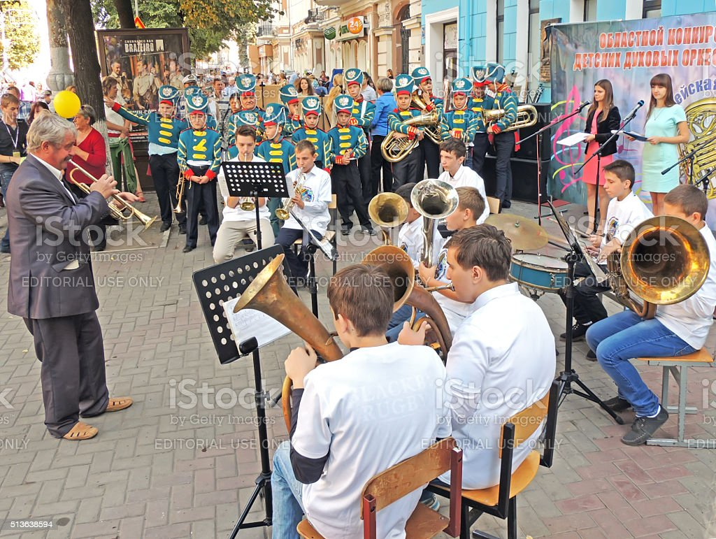 Conductor and his brass band of pupils stock photo