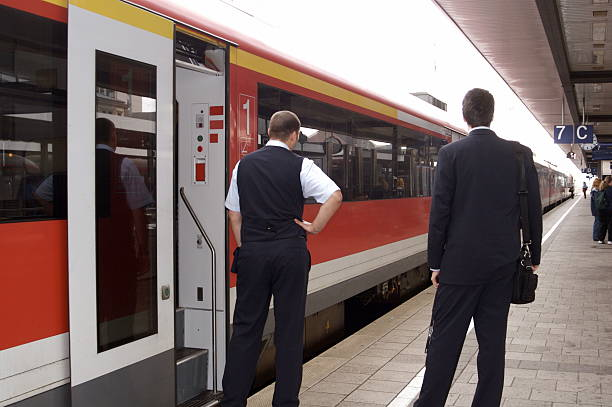 conductor and porter on european train - transport conductor stock photos and pictures